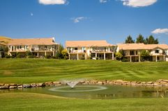 Country club. Adobe style homes at a country club, with a golf course and fountain stock photos