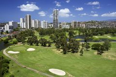 Country Club Hawaii. Scenic aerial view of country club in Hawaii with condo buildings overlooking with blue sky and clouds Stock Photography