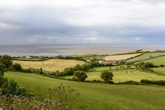 Country and coast near st Audries bay, Somerset. Landscape of the countryside of Somerset with the Bristol Channel sea in background royalty free stock photography