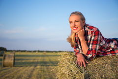 Country concept - happy beautiful romantic woman lying on haysta Royalty Free Stock Image