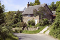 Country Cottage. View of a English stone cottage with a road in the foreground Stock Photography