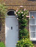 Country cottage door roses Stock Photos