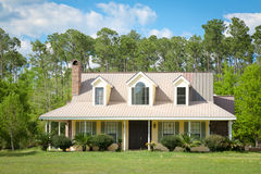 Country Cottage Home and Garden. Cute American cottage style home with white trim Stock Photo