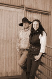 Country Couple. Sepia shot of a young country farming couple Royalty Free Stock Photo