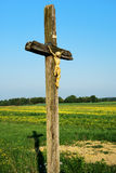 Country cross. A christian croos and its shadow in a blooming meadow stock photography