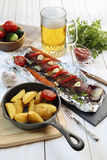 Country dinner - roasted veal chops with vegetables , potatoes a Royalty Free Stock Photos