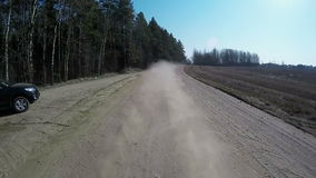 Country driving car on gravel road using a fisheye lens. Slow motion stock footage