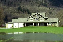 Country Estate. Country mansion with a flooded front lawn Stock Photography