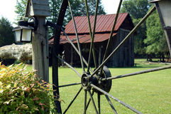 Country farm. A view of a country farm through a wagon wheel royalty free stock photography