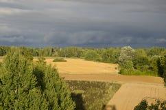 Country farm fields under stormy sky Stock Photography