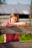 Country Farm Girl. A country farm girl taking a break Stock Photos