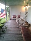 Country farm house front porch American  flag. Farm house front porch Stock Photos