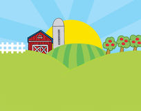 Country farm scene. The sun rising behind a silo, barn, orchard, hills and crops on a farm Stock Image