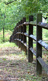 Country fence. A three rail fence with black timbers in a country setting Stock Image