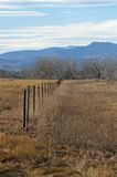 Country. Fence with mountains in back ground royalty free stock photography