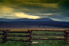 Country Fence and Summer Storms Royalty Free Stock Images