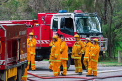 Country Fire Authority fire fighters in Melbourne, Australia. Fire fighters from the North Warrandyte brigade of the Country Fire Authority, practicing by the Stock Image