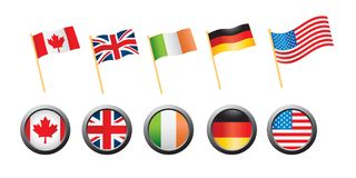 Country flags and pins on white background. Canadian, British, Irish, German, and United States flags and pins on white backdrop Royalty Free Stock Photo