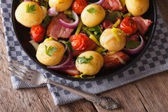 Country Food: Young potatoes with onions and bacon top view Stock Photos
