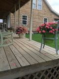 Country Front Porch and Rocking Chairs. Rustic Tennessee  front porch with trailing pansies and impatience Royalty Free Stock Photography
