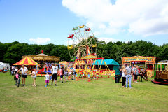 Country funfair. ELVASTON, DERBYSHIRE, UK. JULY 04, 2015. Families enjoying the funfair in the countryside at the Elvaston Steam Rally in Derbyshire, UK stock photo