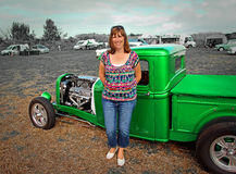 Country gal vintage customised truck. Photo of a country gal standing next to a customised vintage ford pickup truck showing at the whitstable vintage car show Royalty Free Stock Photography