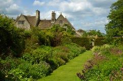 Country Garden. A beautiful english country garden on a hot early summer day Royalty Free Stock Photos
