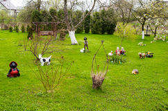 Country garden with plastic figures Royalty Free Stock Photos