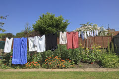 Country Garden Washing Line. Clean Washing hanging out to dry on a Country Garden Washing Line in the Summer sun stock photos