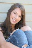 Country girl. Beautiful girl wearing ripped denim Stock Image