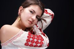 Country girl. In traditional blouse with red flowers Stock Photography
