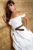 Country Girl. Mexican country girl in hay Royalty Free Stock Photography