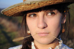 Country girl. Close-up Portrait of a serious young beautiful country girl Stock Photo