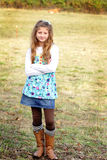 Country Girl. A pretty young farm girl with long blond hair, standing in a field. Shallow depth of field Stock Images