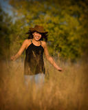Country girl. Young girl running through the tall grass Royalty Free Stock Photography
