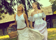 Young girl and woman on old farm Royalty Free Stock Photos