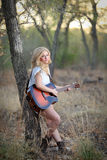 Country Girl with Acoustic Guitar Stock Photo