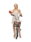 Country girl with bicycle and flowers Royalty Free Stock Images