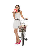 Country girl with bicycle and flowers Stock Photo