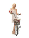 Country girl with bicycle and flowers Royalty Free Stock Photos