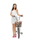 Country girl with bicycle and flowers Stock Image