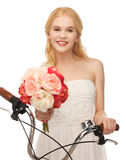 Country girl with bicycle and flowers Stock Photos