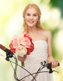 Country girl with bicycle and flowers Royalty Free Stock Image