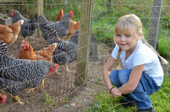 Country girl with chickens Royalty Free Stock Image
