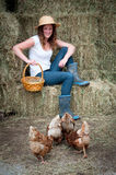 Country Girl with chickens Stock Photo