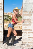 Country girl in doorway Stock Image