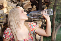 Country girl  drinking water Stock Images
