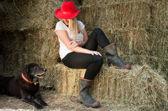 Country Girl and farm dog Royalty Free Stock Photos