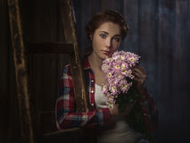 Country girl with flowers Stock Photo