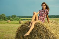 Country girl on fresh hay Royalty Free Stock Photography